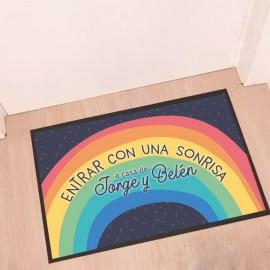 Felpudo arcoiris mensaje